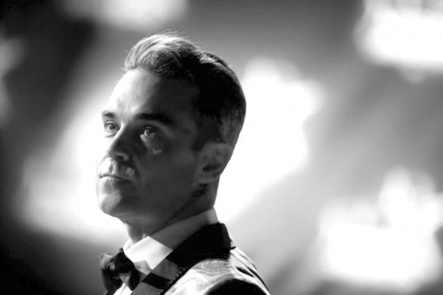 Robbie Williams şi-a angajat gărzi de corp care să îl apere de extratereştri
